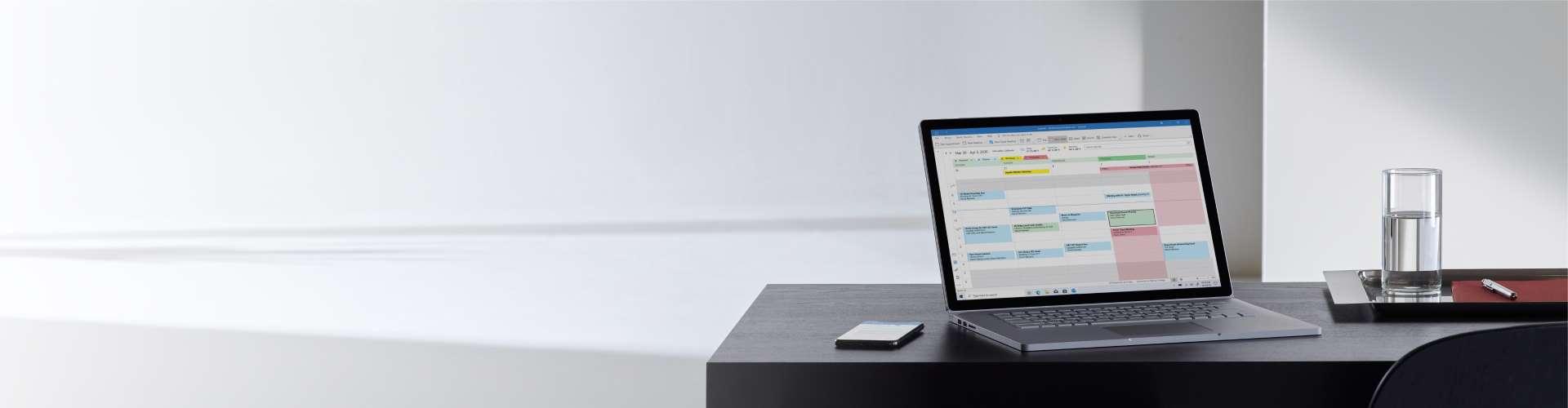 Outlook op laptop en mobiel